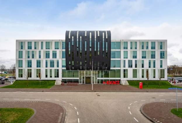 a.s.r. real estate acquires Exact HQ office building on TU Delft campus