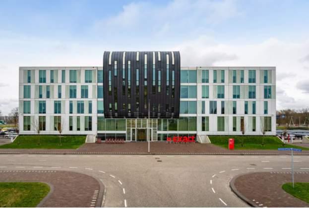 a.s.r. real estate koopt kantoorgebouw Exact HQ op de TU Delft Campus